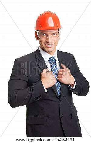 Young businessman in a helmet