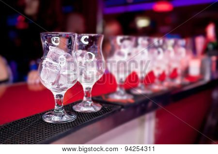 Glasses with ice on the bar counter