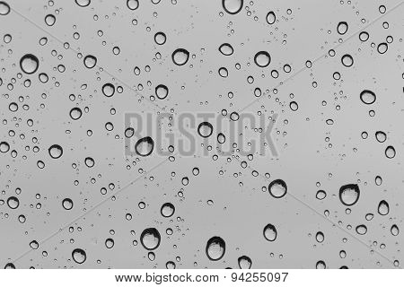 Water drop on glass mirror background.