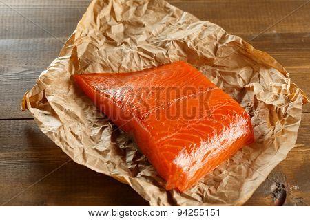 Salmon steak on old papper.
