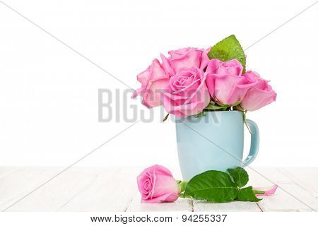 Pink roses bouquet on wooden table with copy space