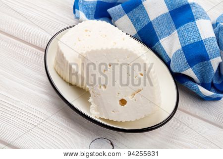 Dairy products on wooden table. Homemade milk cheese