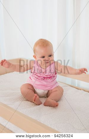 Beautiful cute baby girl in her bed at home in bedroom