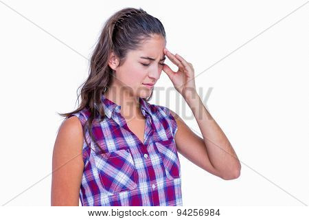 A pretty brunette with headache on white background