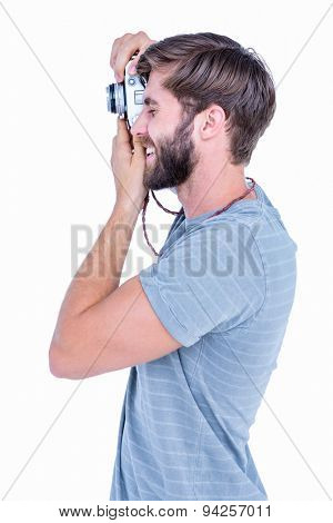 Happy handsome man taking pictures on white background