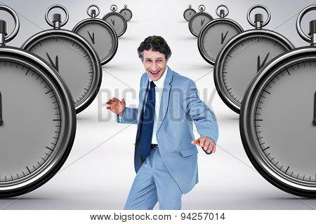 Smiling businessman against grey background