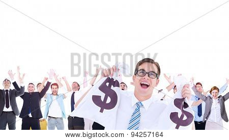 Composite image of geeky happy businessman holding bags of money in hands