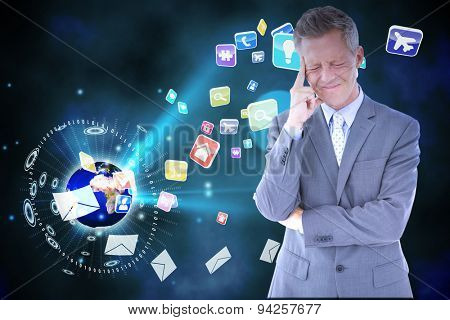 Businessman with headache against global communication background
