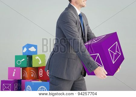 Businessman holding something with his hands against grey sky