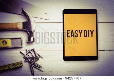 The word easy diy and tablet pc against blueprint