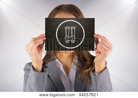 Businesswoman showing card against grey background