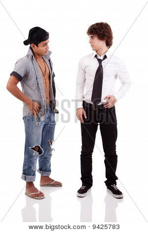 Two Men Of Different Ethnicity, One Looking At The Other Standing, Isolated On White, Studio Shot