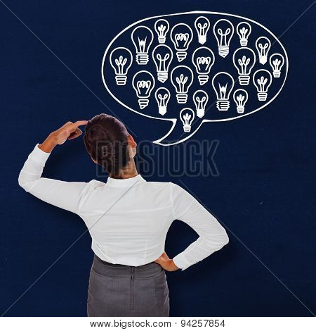 Businesswoman scratching her head against navy blue