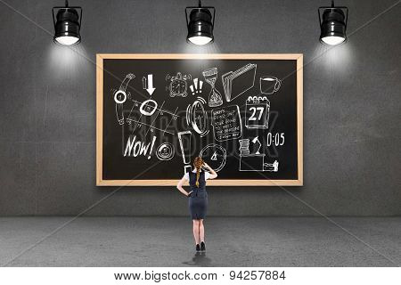 Redhead businesswoman scratching her head against blackboard with copy space