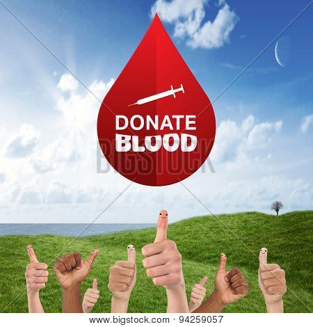 Donate blood against green field under blue sky