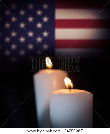 Usa national flag against blazing candles