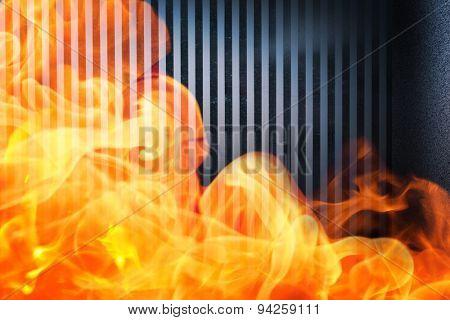 Fire against dark grey room