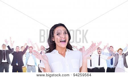 Composite image of surprised brunette with hands up and smiling