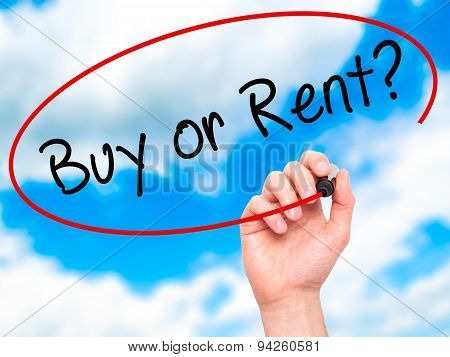 Man Hand writing Buy or Rent? with black marker on visual screen.