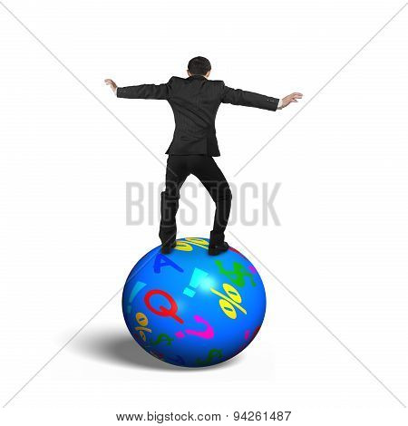 Businessman Balancing On The Colorful Symbols Ball