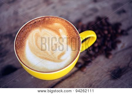 Coffee Mocha Hot And Coffee Beans On Wooden Table