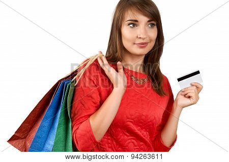 Smiling Woman With A Gift Bag And A Credit Card
