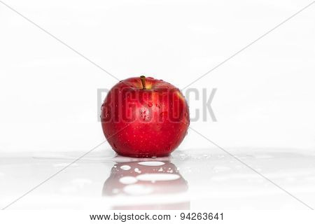 Red Apple In Water Splashing
