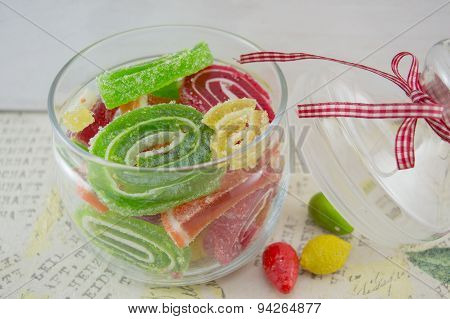 Colorful Jelly Rolls In A Jar On A Decoupage Table