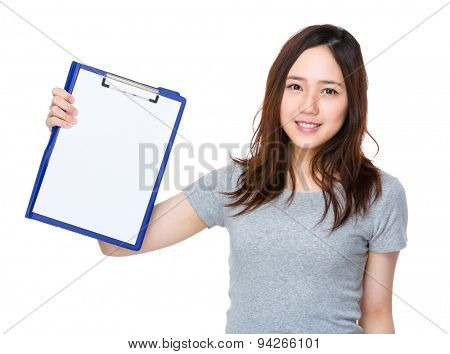 Woman show with blank page of clipboard