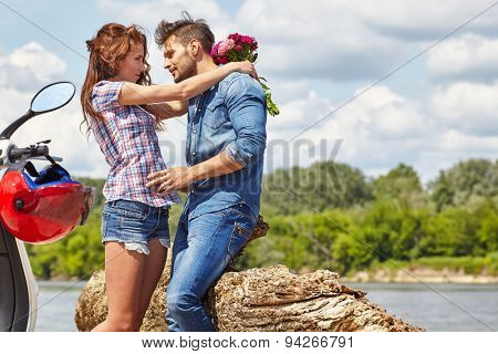 Love couple on a trip on the river