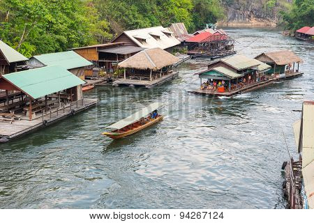 Tourism on the floating house rafting  at the river Kwai,  Kanchanaburi ,Thailand.