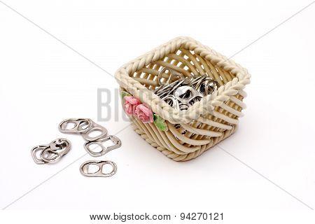 Soda can tabs in ceramic basket