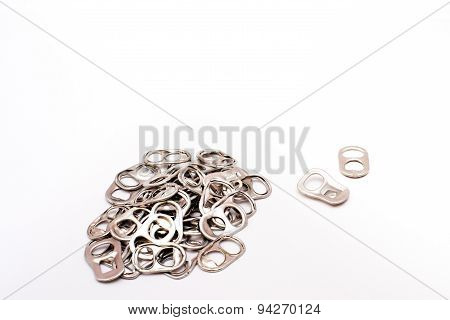 Soda can tabs on white background