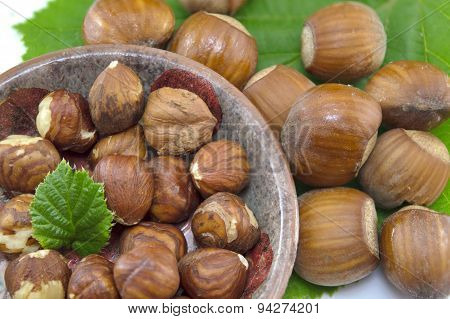 Raw Hazelnuts In A Bowl With A Green Leaf