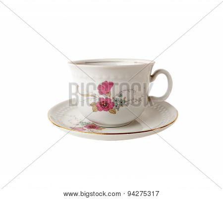 Tea cup and saucer of porcelain with floral patterns isolated over white