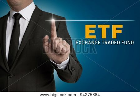 Etf Touchscreen Is Operated By Businessman