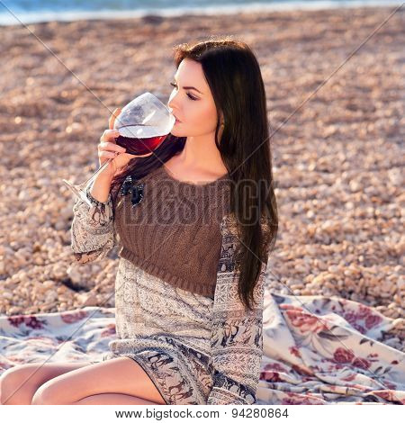 Young Woman Holding Glass Of Red Italian Wine. Sunset