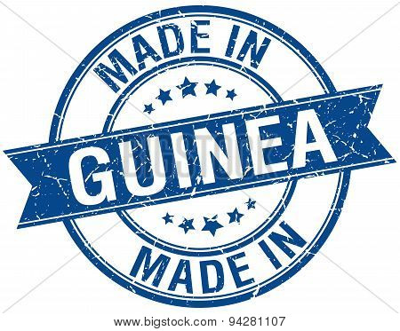 Made In Guinea Blue Round Vintage Stamp