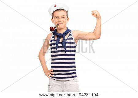 Little kid in sailor outfit showing his bicep and holding a pipe in his mouth isolated on white background