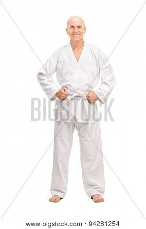 Full length portrait of a joyful senior in a white kimono with a white belt looking at the camera and smiling isolated on white background