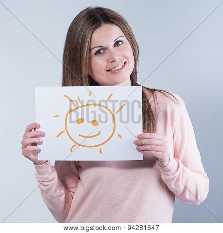 Young Woman Holding A Cardboard With A Sun