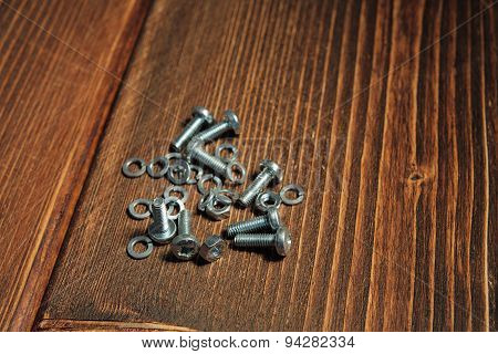 Screws on the wooden background