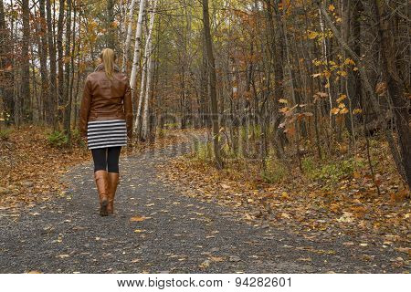 Unrecognizable woman in path