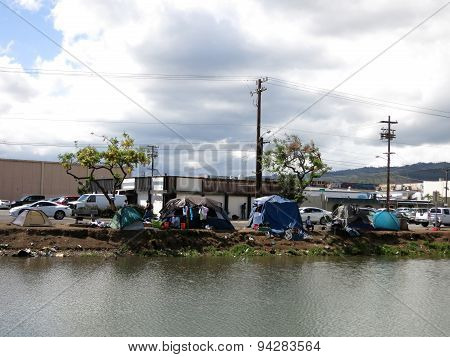 Homeless Tents And Cars Parked Along The Kapalama Canal