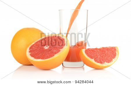 Studio Shot Sliced Grapefruits With Poured Juice On White