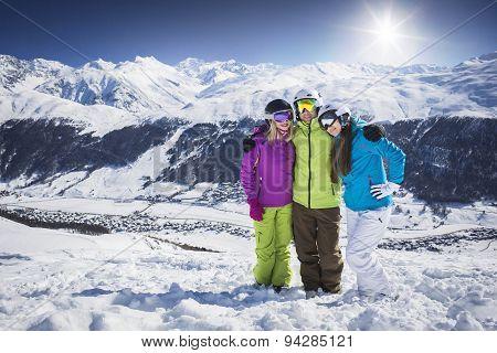 Young people hugging and posing ski resort