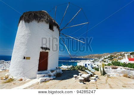 White greek windmill overlooking traditional village on Mykonos Island, Greece, Europe