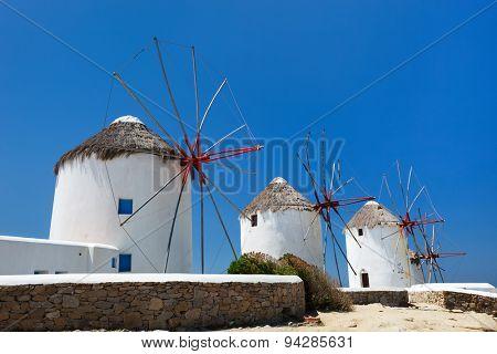 Traditional white greek windmills popular tourist destination on Mykonos Island, Greece, Europe