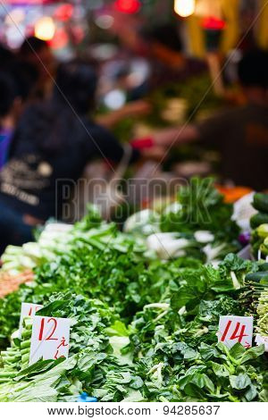 Variety of fresh green herbs on market stall