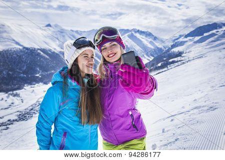 Girls are making selfie photo ski resort